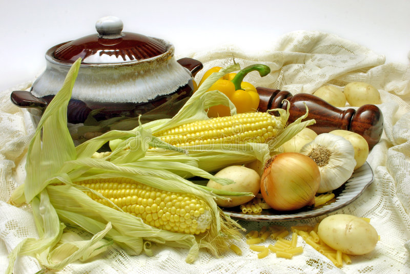 Soup Ingredients. Chowder vegetables, arranged with soup tureen and lace cloth photographed with white background stock photo