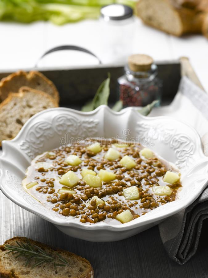 Soup with lentils and potatoes royalty free stock photos