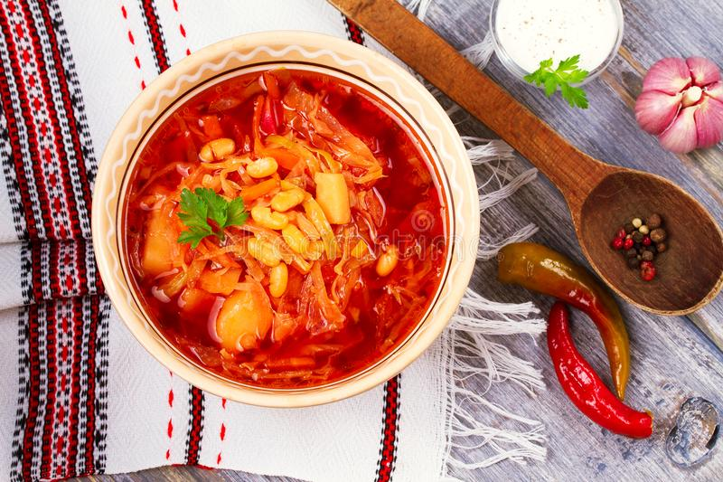 Soup made with vegetables, bean and beet root: borsht, bortsch, borshch, borscht. Traditional dish in Ukraine, Russia, Poland. View from above, top studio shot stock images