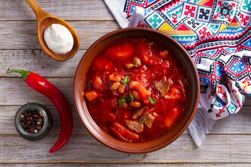 Soup made with vegetables, meat, bean and beet root: borsht, bortsch, borshch, borscht. Traditional dish in Ukraine, Russia, Poland. View from above, top royalty free stock image