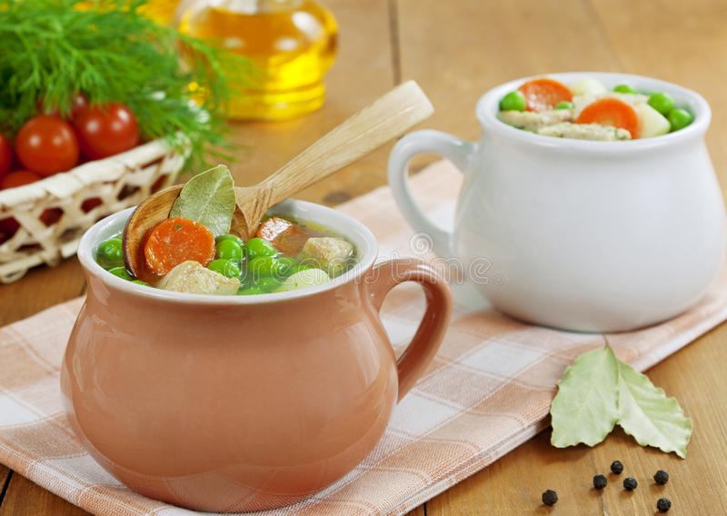 Soup with meat and green peas royalty free stock image