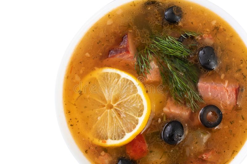 soup with meat, olives, lemon, seasonings and spices. isolated Russian Solyanka, homemade food. Top view royalty free stock photo