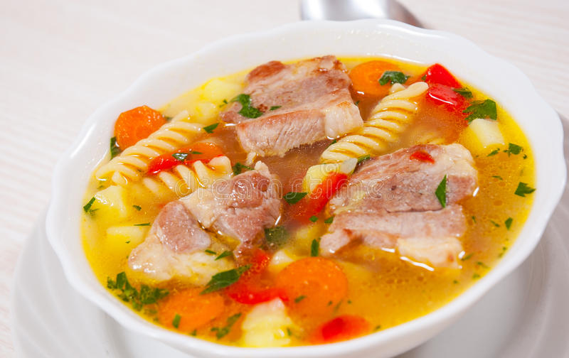 Soup with meat, pasta and vegetables royalty free stock image