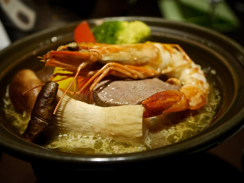 Soup with Mushrooms, Shrimps and Vegetables. Delicious Japanese style soup with mushrooms, meat, shrimps and vegetables. Nagano, Japan stock photo