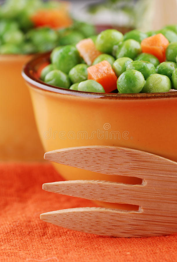 Soup of peas and carrots stock images