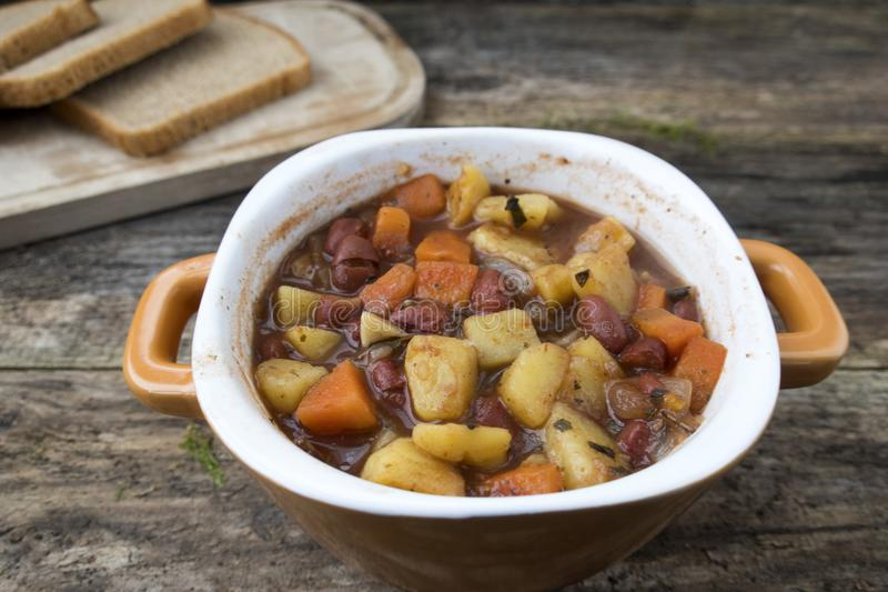 soup with potatoes, onions, carrots and beans royalty free stock photography