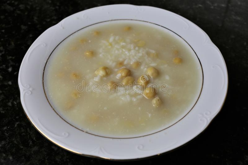 Soup of rice and chickpeas typical Andalusian and Spanish cuisine. Soup of rice and chickpeas a typical meal of the Andalusian and Spanish cuisine. The soup is royalty free stock photography