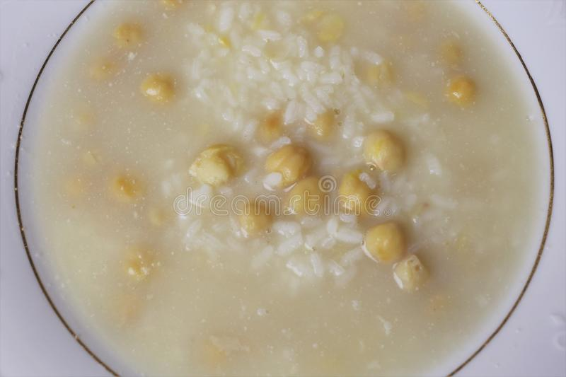 Soup of rice and chickpeas typical Andalusian and Spanish cuisine. Soup of rice and chickpeas a typical meal of the Andalusian and Spanish cuisine. The soup is stock photography