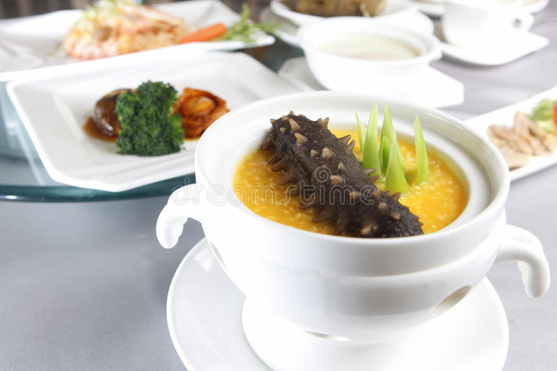 Soup with sea cucumber. In the bowl royalty free stock photography