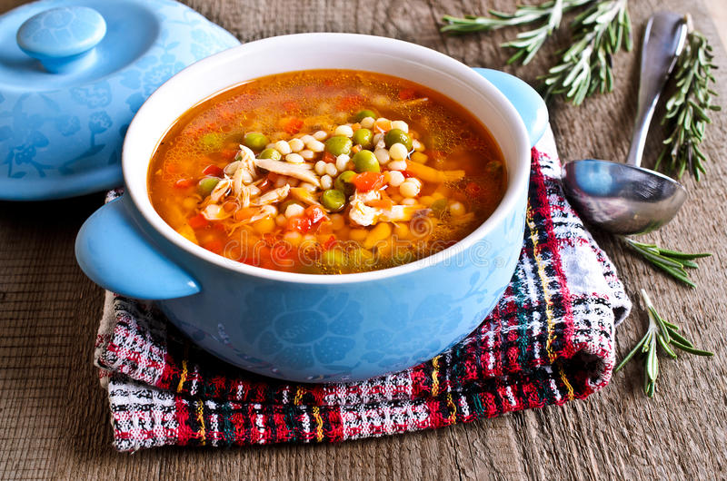 Soup with small pasta, vegetables and pieces of meat royalty free stock photo