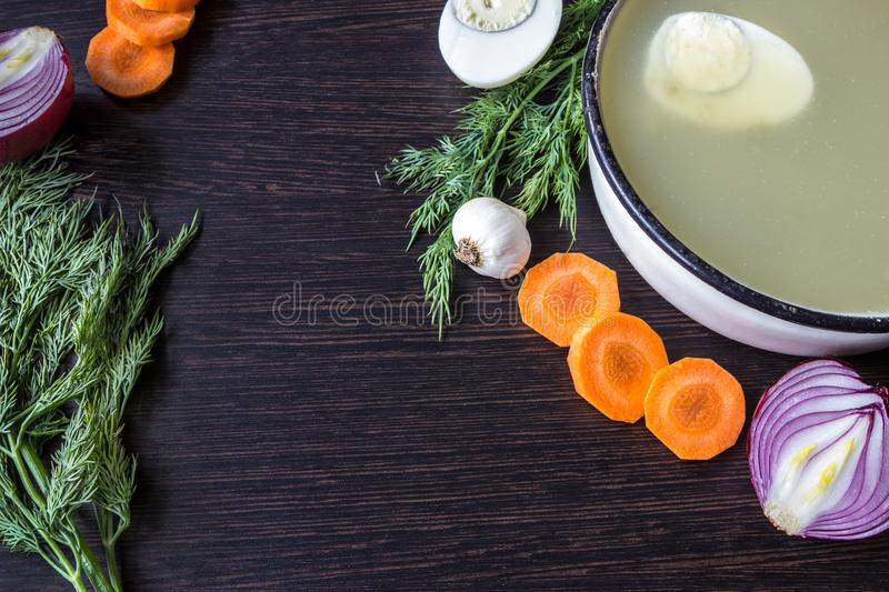 Soup with sorrel, vegetables and boiled egg, red onion, carrots, garlic, dill on dark wooden table. royalty free stock photography