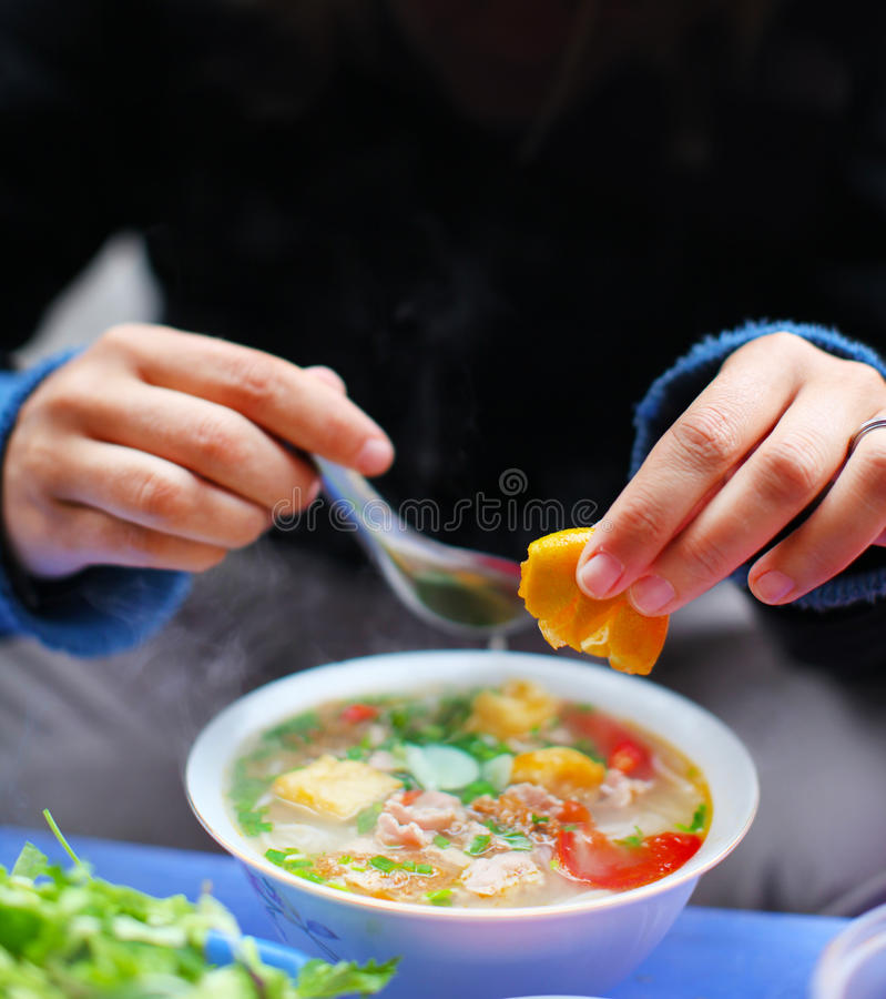 Soup with tofu and chicken with squeeze of lemon royalty free stock photo