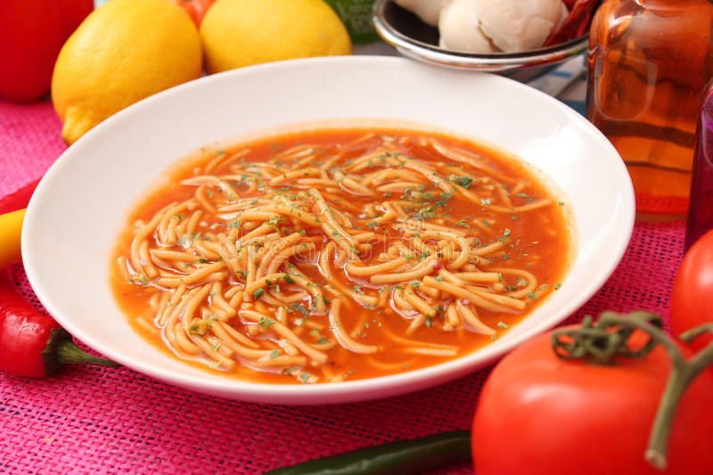 Soup of tomatoes with noodles royalty free stock images