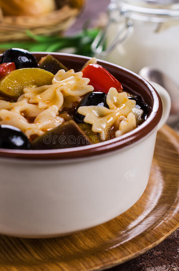 Soup with vegetables. And pasta. Selective focus royalty free stock image