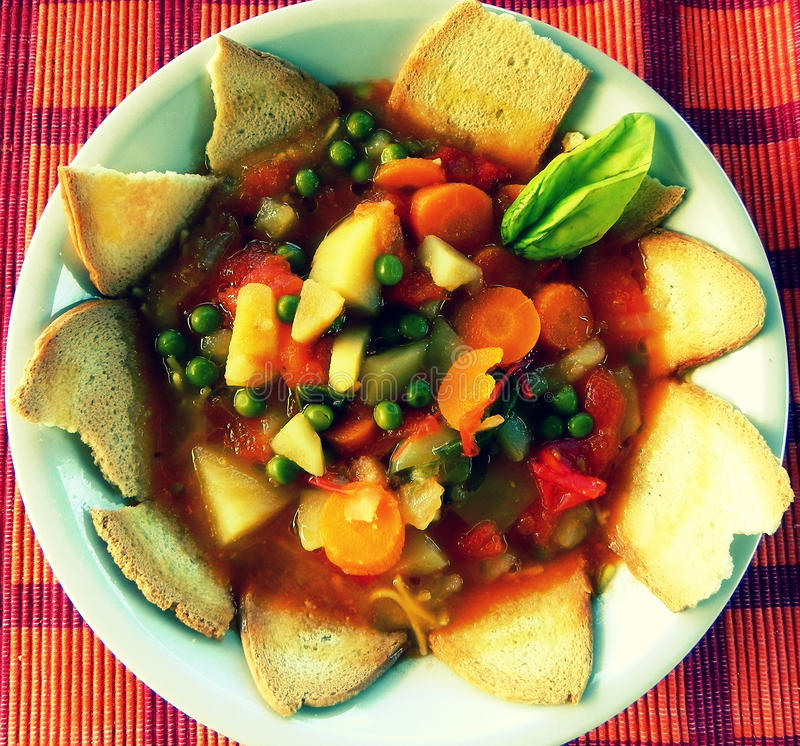Soup. A vegetables soup in a plate with bread stock image