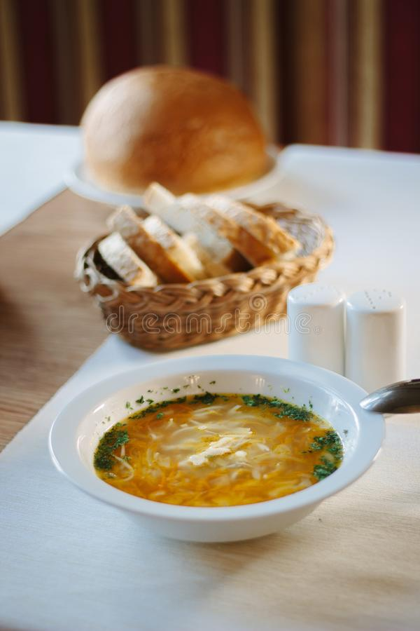 Soup at white ceramic plate at the table. Soup at white ceramic plate at the table stock photo