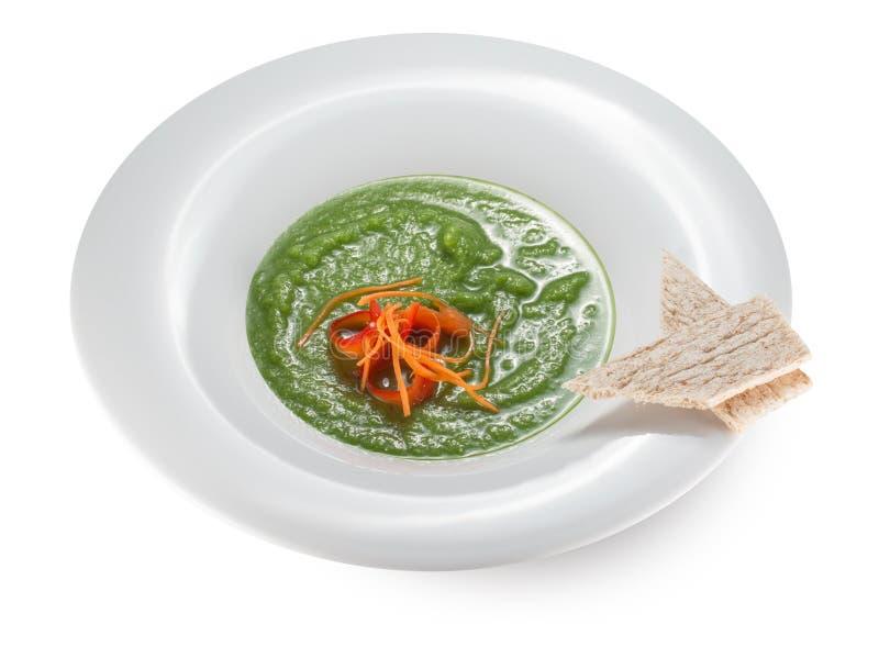 Soupe à brocoli dans un plat photographie stock libre de droits