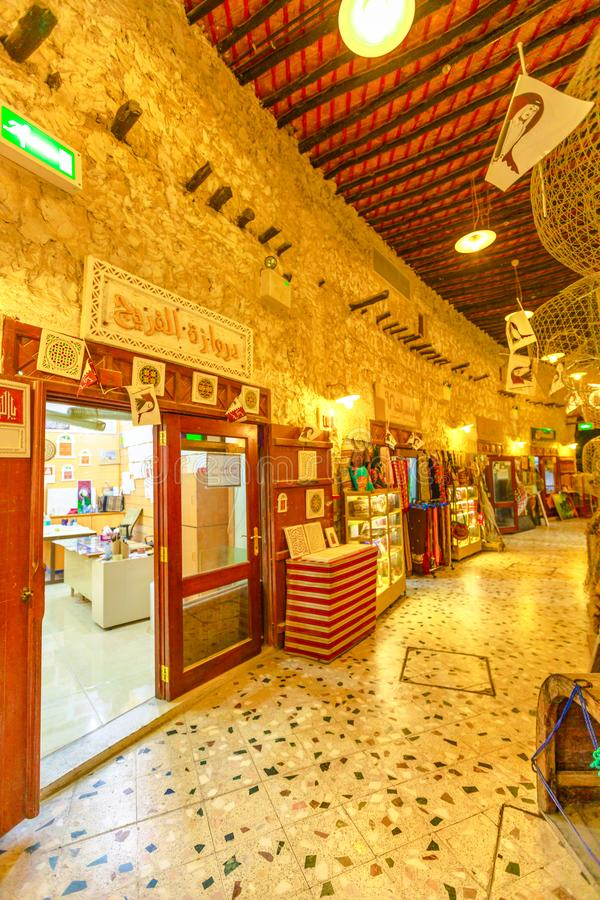 Souq Waqif Doha. Doha, Qatar - February 17, 2019: inside narrow alleyways of Souq Waqif, the old traditional market. The souq is best location for tourists and royalty free stock photo