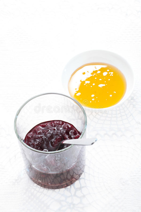 Sour cherry jam and honey royalty free stock photography