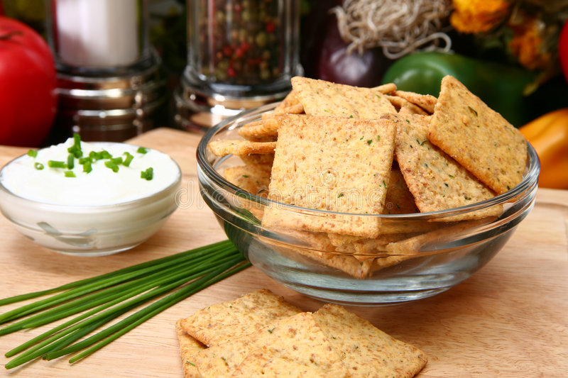 Sour Cream and Chive Flavored Crackers stock images