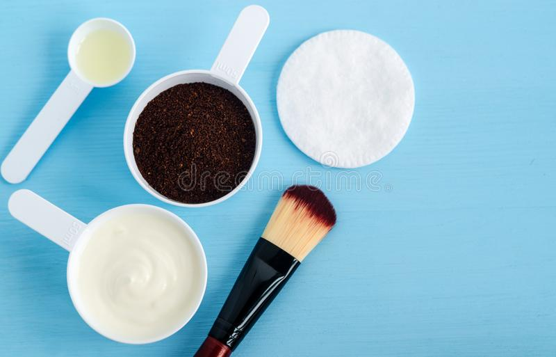 Sour cream greek yogurt, ground coffee and olive oil in a small scoops. Ingredients for preparing diy masks, scrubs, moisturizer royalty free stock image