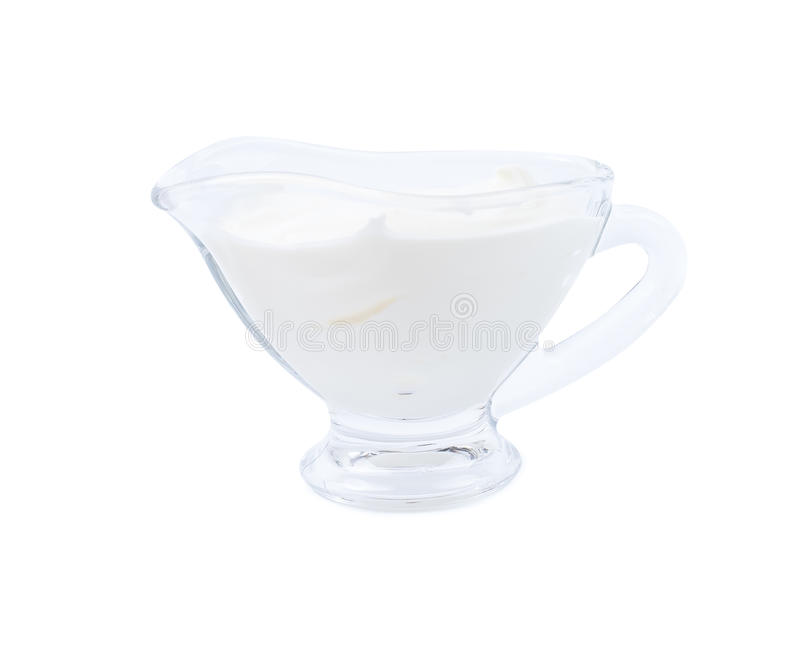 Sour cream in a sauce-boat. Isolated royalty free stock images