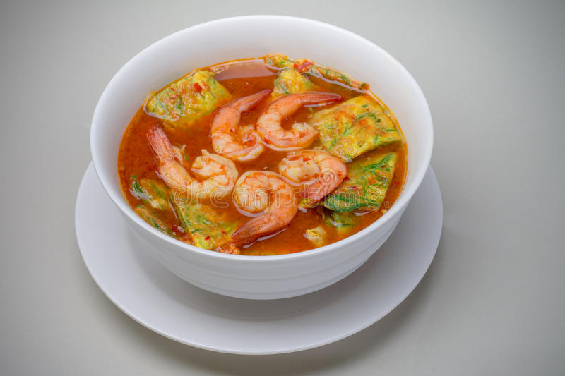 Sour soup with shrimp and Acacia Pennata omelette stock image
