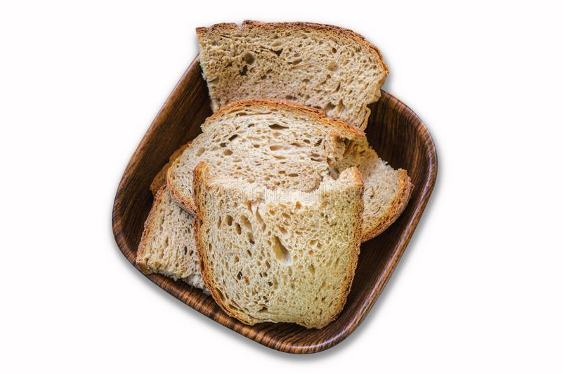 Sour yeast bread slices in the basket on white background royalty free stock images