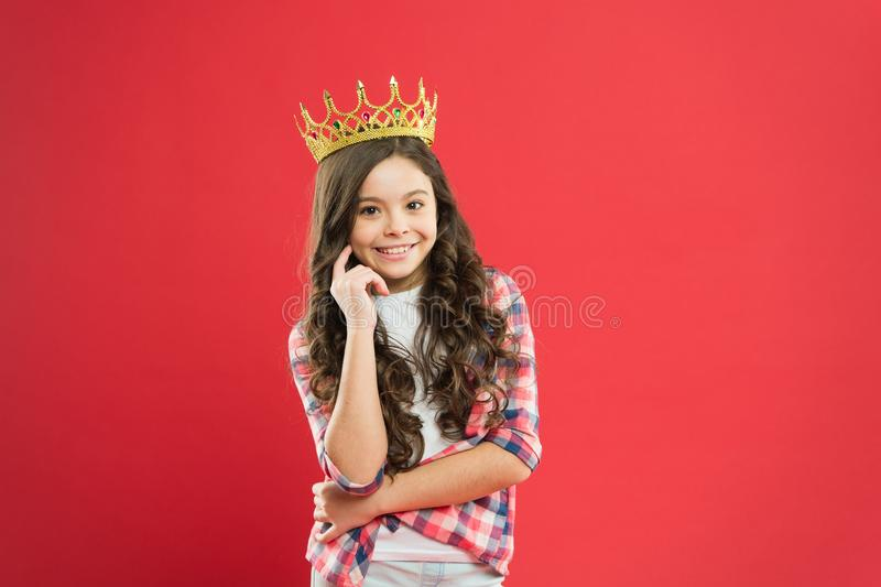 Source of pride. Proud little girl wearing crown jewel with pride on red background. Adorable small child with long royalty free stock photos