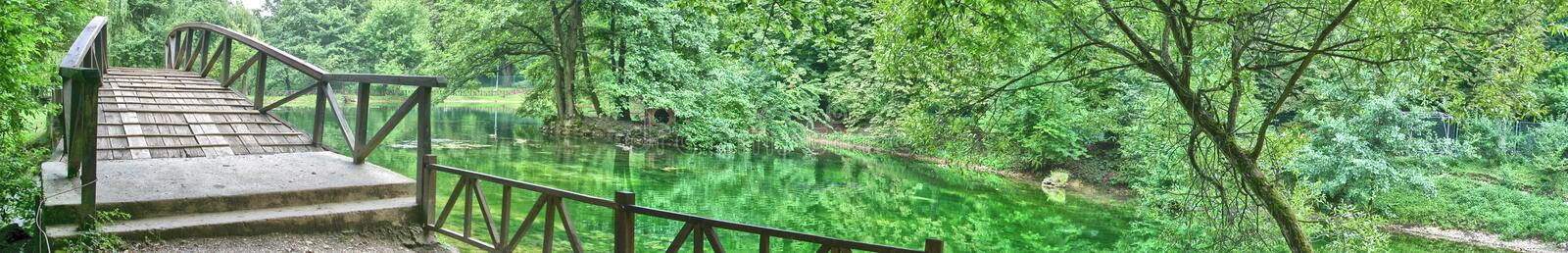Source of river Bosna. Nature park Source of river Bosna wide panorama royalty free stock photography