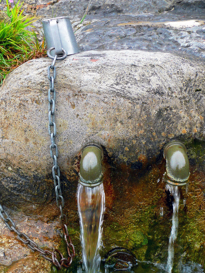 Source of spring water flowing royalty free stock photos