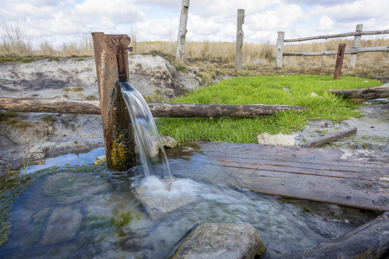Source of spring water. Natural source of spring water in park royalty free stock photo