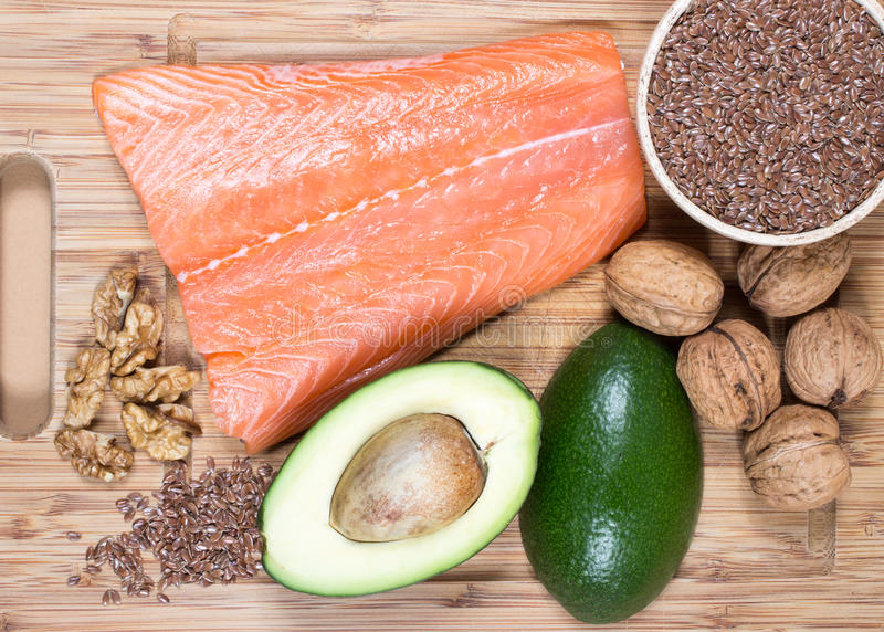 Sources of omega 3 fatty acids: flaxseeds, avocado, salmon and walnuts. Sources of omega 3 fatty acids stock photo