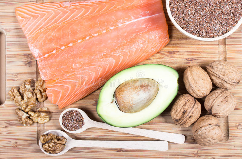 Sources of omega 3 fatty acids: flaxseeds, avocado, salmon and walnuts. Sources of omega 3 fatty acids royalty free stock photos