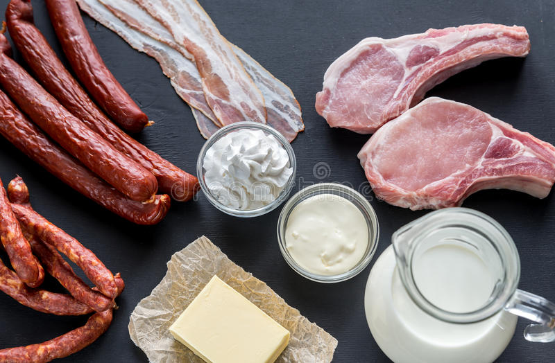 Sources of saturated fats. On the dark wooden background stock image