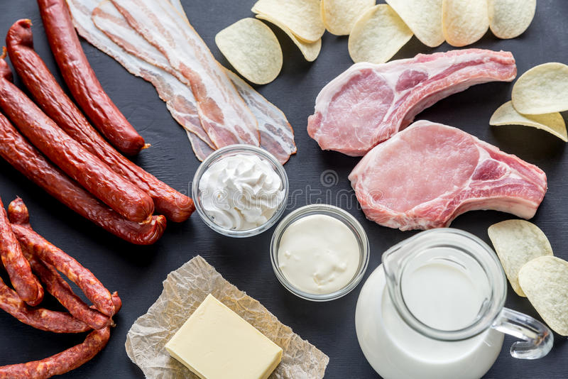 Sources of saturated fats. On the dark wooden background royalty free stock photos