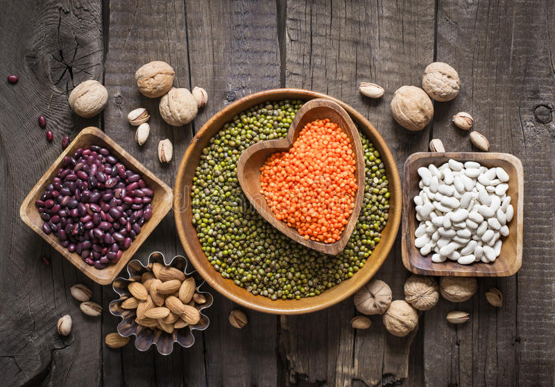 Sources of vegetable protein are various legumes and nuts. Top view.  royalty free stock image