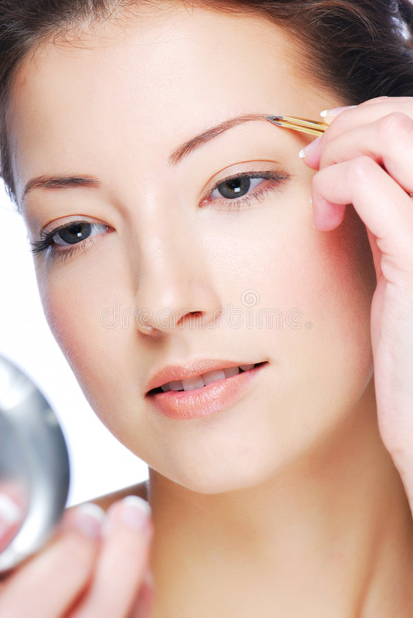 sourcils depilating photo stock