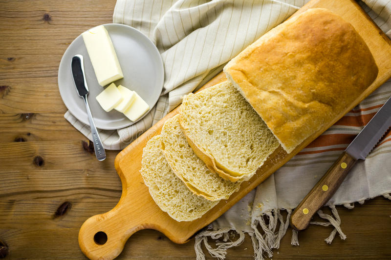 Sourdough bread. Freshly baked sourdough bread sliced on cutting board royalty free stock images