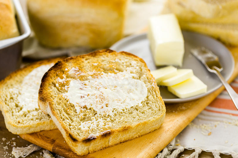 Sourdough bread. Freshly baked sourdough bread sliced on cutting board stock images