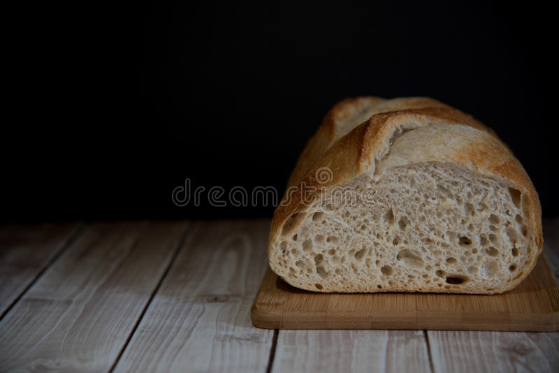 Sourdough homemade bread on the wooden board, copy space. royalty free stock images