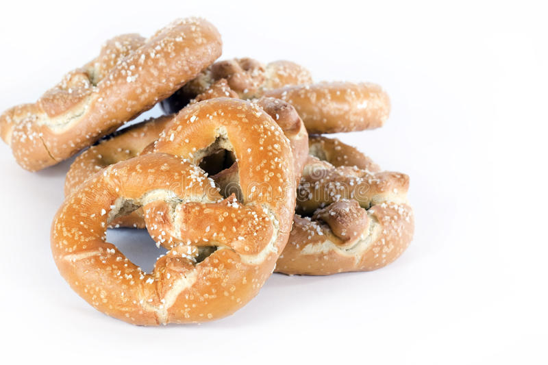 Sourdough Pretzels. Large hard twisted and salted sourdough pretzels on white background stock photography