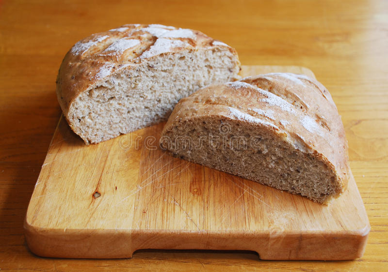 Sourdough on Wooden Chopping Board royalty free stock image