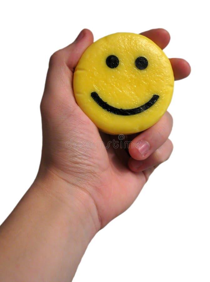 Sourire à un arrière-plan de blanc de remise photo libre de droits