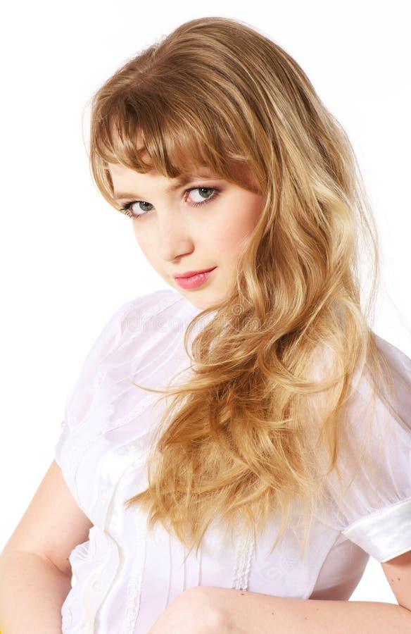 sourire blond de cheveu de fille longtemps d'adolescent image libre de droits
