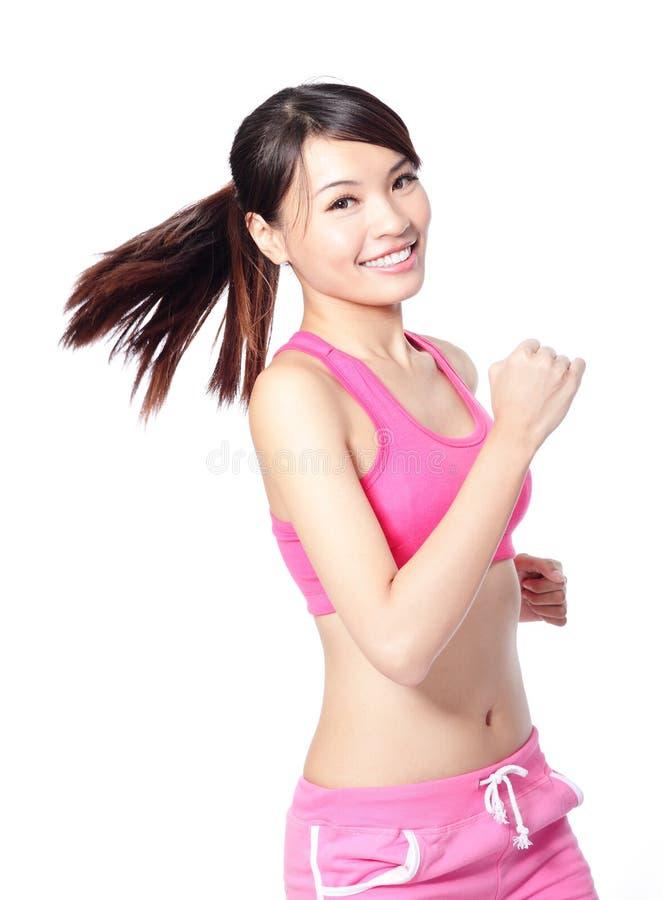 Sourire courant de femme de sport de forme physique image stock