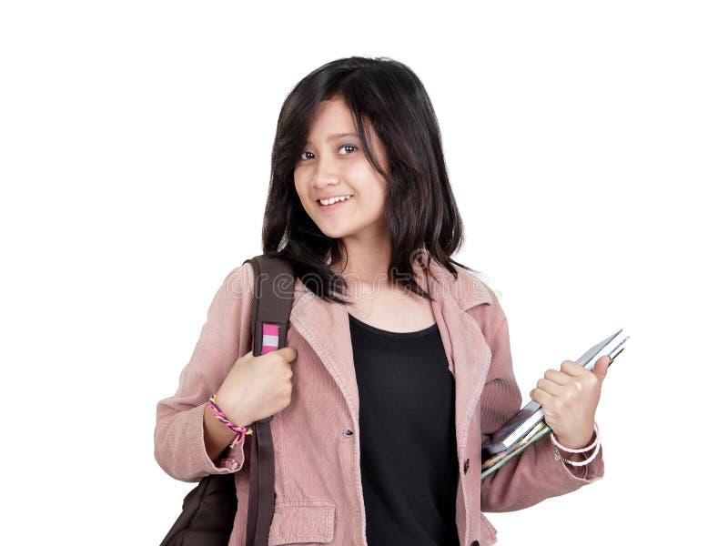 Sourire d'étudiante d'adolescente d'isolement photographie stock libre de droits