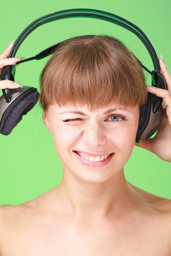 sourire de dame d'écouteurs photos stock