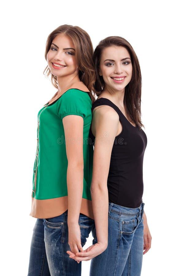 Sourire de deux adolescentes photographie stock libre de droits