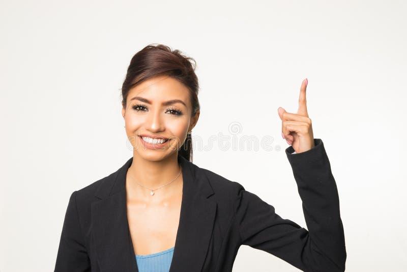 Sourire de femme de pointage images stock
